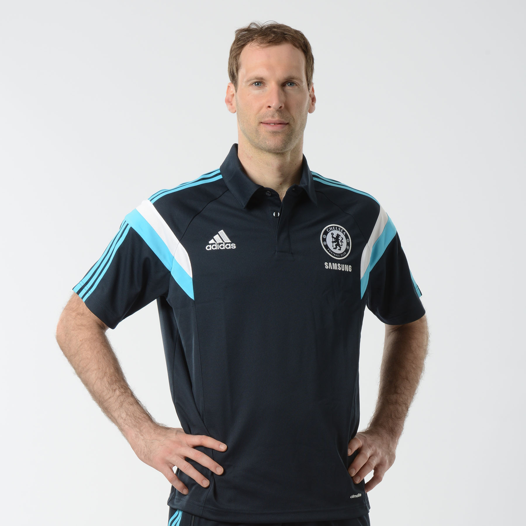 Chelsea Training Polo Dark Blue Enjoy a casual look casual with this dark blue Chelsea Training Polo. Made from soft, lightweight fabric, you can enjoy superior moisture management when you're out training in this adidas top.   Styled with a Chelsea club crest lion badge, adidas performance logo and stripes and a stylish buttoned collar, you can wear this Chelsea training top for club pride, comfort and style.   Benefits of this Chelsea Training Polo •Superior moisture management so you can stay cool and dry when the game heats up •Chelsea club crest on the chest •adidas three stripe logo