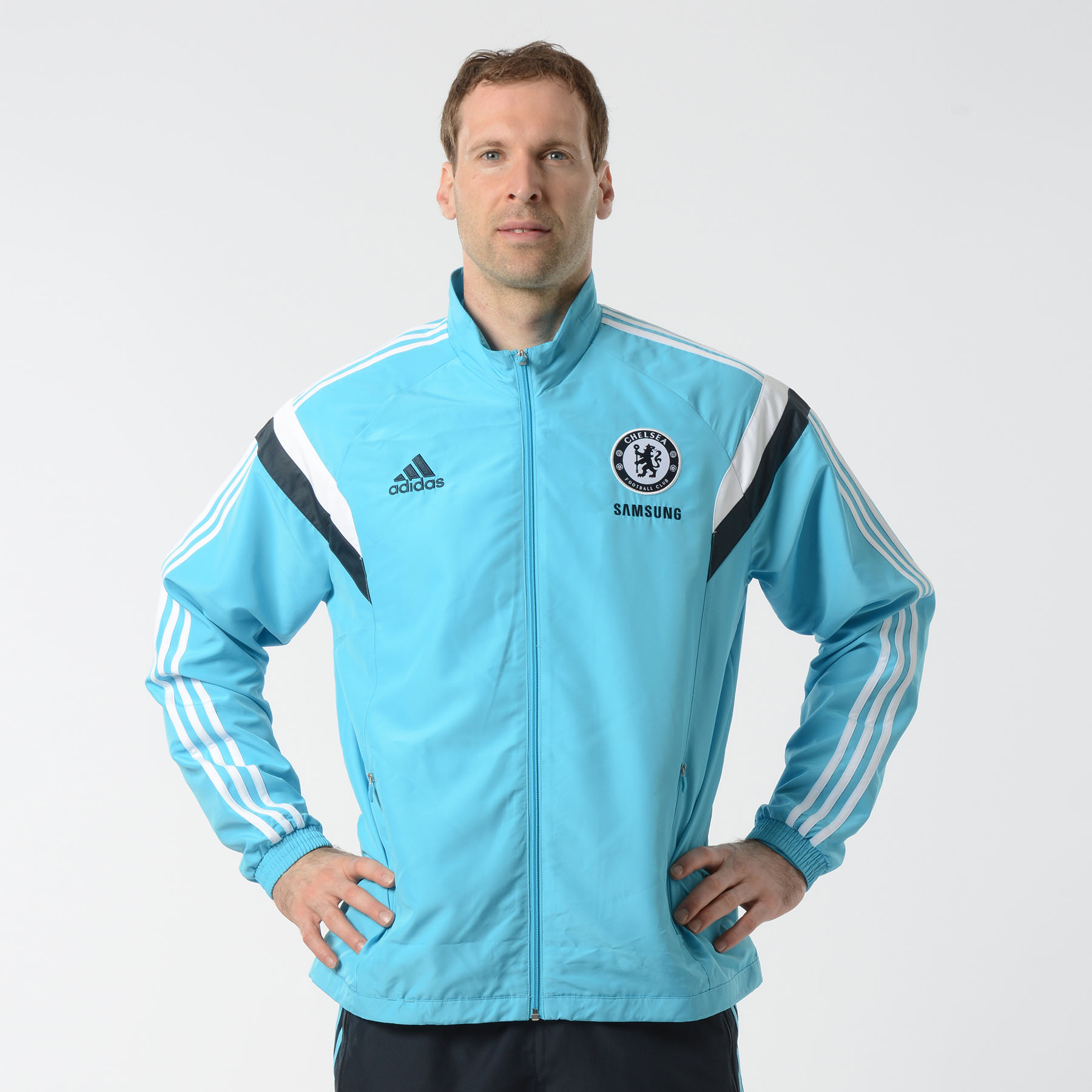Chelsea Training Presentation Jacket Blue   Enjoy a great performance every time you play in this Chelsea Presentation Jacket. Styled with a woven Chelsea club crest and adidas three stripe logo, this blue presentation jacket was designed with style in mind.   Featuring a zip front, elasticated cuffs and a full mesh lining, this comfortable and lightweight Chelsea presentation suit is perfect whether you're training or traveling down to Stamford Bridge.   Benefits of this Chelsea presentation suit •Built with a full mesh lining which lifts the fabric away from the skin's surface and allows the air to circulate around the body •Zip front •Elasticated cuffs •Team crest and adidas logo for team pride and style