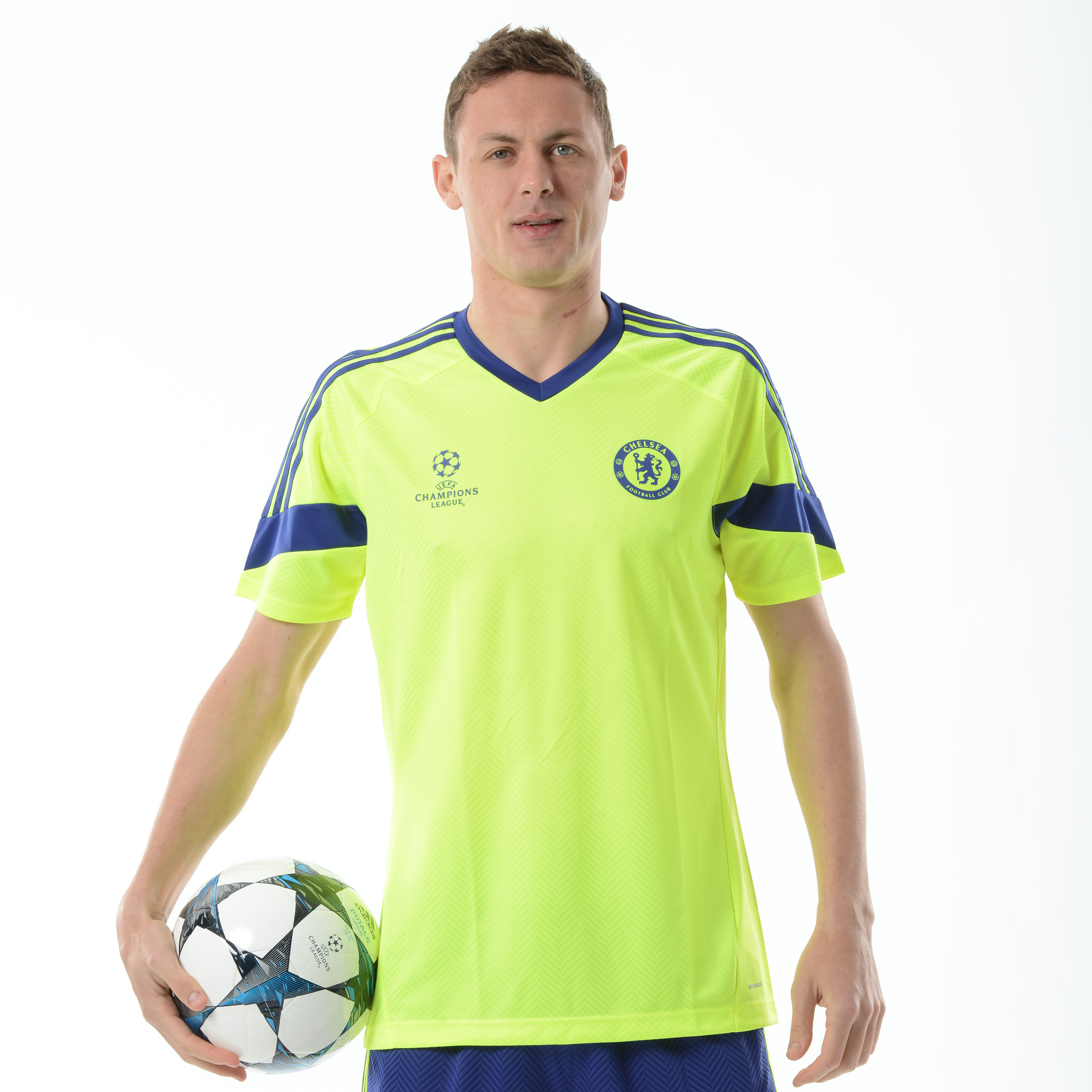 Chelsea UCL Training Jersey   Fans can support their favourite team with style and pride with this yellow Chelsea UCL training t-shirt which features a team badge on the left of the chest for pride. With stripes down each arm, this UCL training t-shirt offers an athletic loo